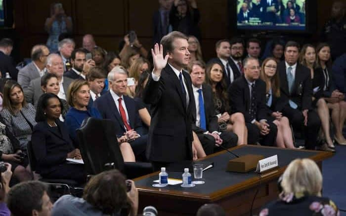 Kavanaugh being sworn in during hearings